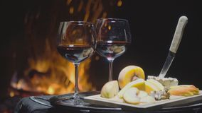 Two glasses of wine on the background of fire stock video footage