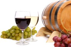 Two glasses of wine, barrel and grape Royalty Free Stock Photos