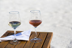 Two Glasses of Wine at the Beach Royalty Free Stock Images
