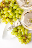 Two glasses of wine, blue cheese and a grapes Royalty Free Stock Photography