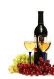 Two glasses of wine, bottle an. D grapes isolated  on white Stock Photography