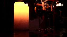 Two glasses of wine in candlelight. Two glasses of wine in the candlelight stock footage