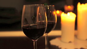 Two glasses of wine with candles stock video