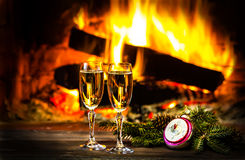 Two glasses of wine and Christmas New Year decoration, fireplace Stock Image