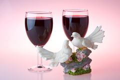 Two glasses of wine and figurine Stock Photo