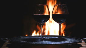 Two glasses of wine with flame on background stock video footage