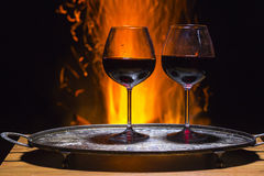 Two glasses of wine with flame on background. Two glasses of wine with campfire  on background Stock Images
