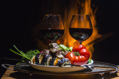 Two glasses of wine with flame on background. Two glasses of wine with campfire on background Royalty Free Stock Photography