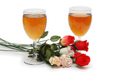 Two glasses on wine and flowers royalty free stock photo