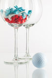 Two glasses of wine and golf equipments Royalty Free Stock Images