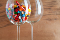 Two glasses of wine and golf tees Stock Images