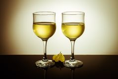 Two glasses of wine and grape berries Stock Photos