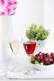 Two glasses of wine with grapes Royalty Free Stock Photos