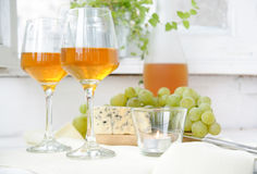 Two glasses of wine, grapes and blue cheese Stock Photos
