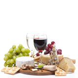 Two glasses of wine, grapes, cheese and crackers, isolated Royalty Free Stock Photo