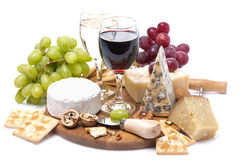 Two glasses of wine, grapes, cheese and crackers Royalty Free Stock Photos