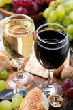 Two glasses of wine, grapes and snacks, close-up Royalty Free Stock Image
