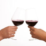 Two glasses of wine in hands isolated Royalty Free Stock Photos
