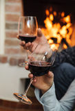 Two glasses of wine in the hands of man and woman Royalty Free Stock Photography