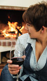 Two glasses of wine in the hands of man and woman Royalty Free Stock Image