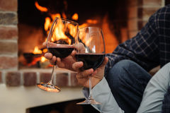 Two glasses of wine in the hands of man and woman Stock Images