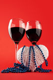 Two glasses of wine and a heart Royalty Free Stock Image