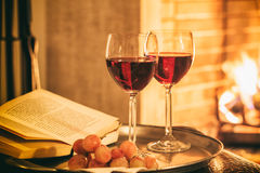 Two glasses of wine near a fireplace Royalty Free Stock Images