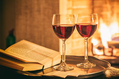 Two glasses of wine near a fireplace Royalty Free Stock Photo