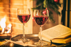 Two glasses of wine near a fireplace Royalty Free Stock Photography