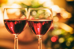 Two glasses of wine near a fireplace Royalty Free Stock Image