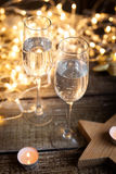 Two glasses of wine. new year decorations. With stars and candles Royalty Free Stock Photos