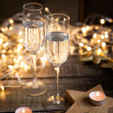 Two glasses with wine. new year decorations. With stars and candles Royalty Free Stock Image