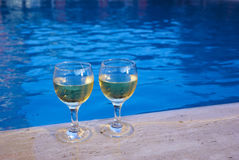 Two glasses with wine at the poolside Royalty Free Stock Photo