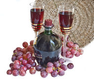 Two glasses with wine and red grape Royalty Free Stock Photography