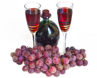 Two glasses with wine and red grape Stock Photography