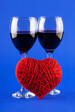 Two glasses of wine and a red heart Royalty Free Stock Image