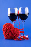 Two glasses of wine and a red heart on a blue Stock Photo