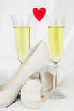 Two glasses of wine and red heart Stock Images