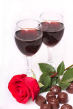 Two glasses of wine with rose and candy Royalty Free Stock Image