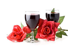 Two glasses of wine, rose and cupid. Stock Photo
