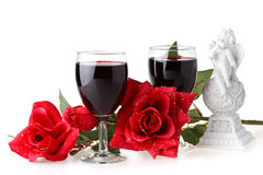 Two glasses of wine, rose and cupid. Royalty Free Stock Photography
