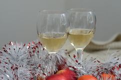 Two glasses of wine, silver decoration and wool Royalty Free Stock Photos