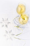 Two glasses of wine and snowflakes Royalty Free Stock Photo