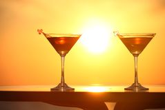 Two glasses of wine on sunset Stock Photos