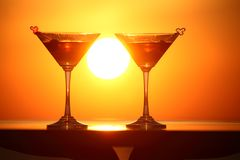 Two glasses of wine on table on sunset Stock Image