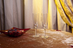 Two glasses of wine on a table in a vintage room Royalty Free Stock Images