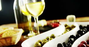 Two glasses of wine and a tray with berry fruits and olives stock video footage