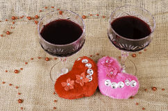 Two glasses of wine and two hearts close-up. Royalty Free Stock Photo