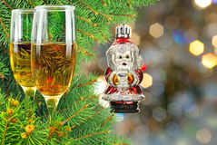 Two glasses of wine under the Christmas tree Stock Image