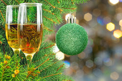 Two glasses of wine under the Christmas tree Royalty Free Stock Photo